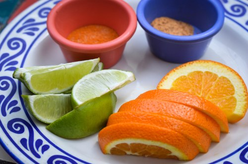 Traditional condiments for mezcal: salt with arbol chiles, sal de gusano, lime, and oranges.